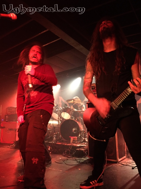Lars Göran Petrov of Entombed AD shows us his party face while guitarist Guilherme Miranda shies away.